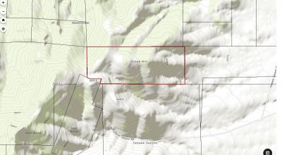 241 acres  Creek Hill in scenic Humboldt Mountains